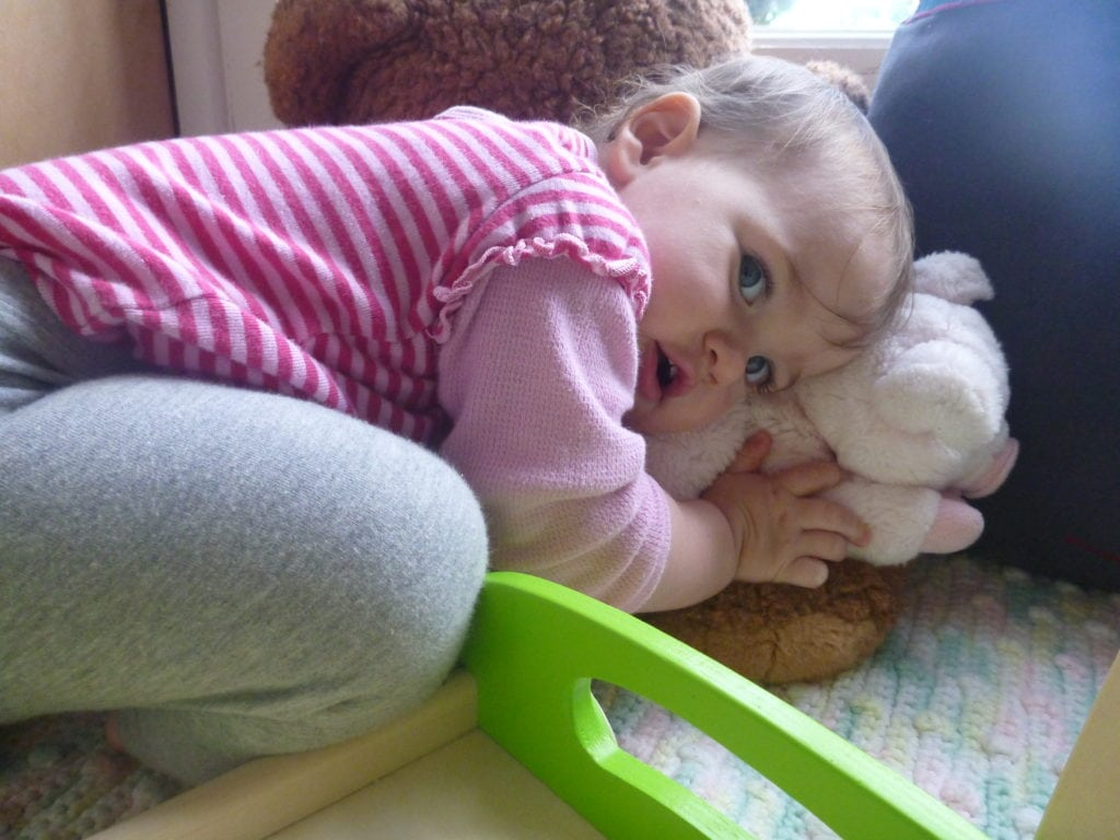 Naptime fears - toddler snuggles lovie from home for comfort