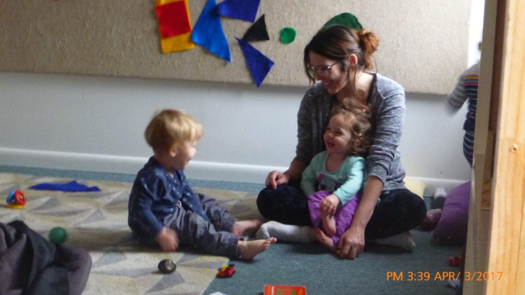 what is high quality early childhood - primary caregiver builds relationships with tots through joyful moments