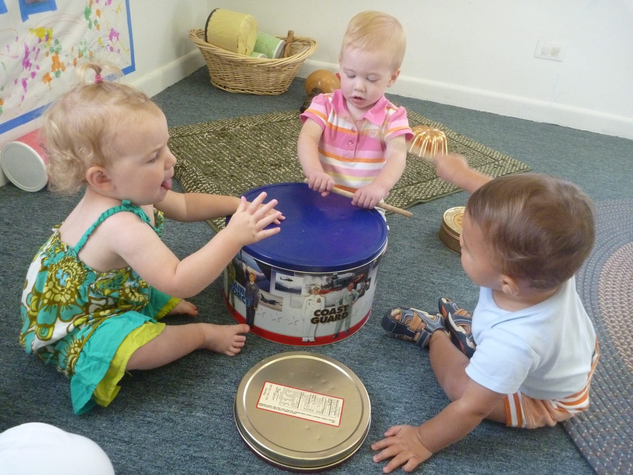 Our Neighborhood Babies banging on the drum