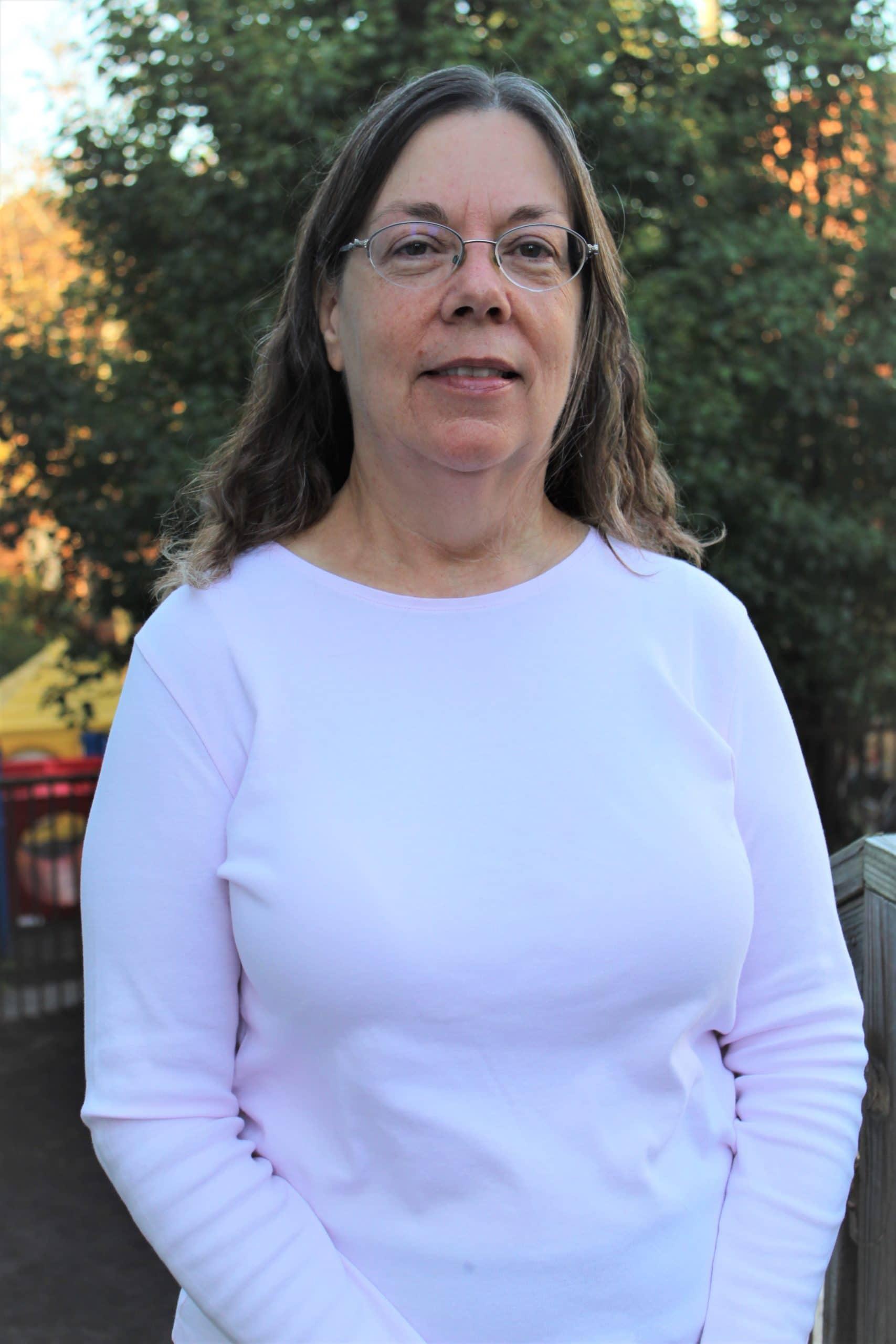 Judi, white shirt, tree background, female, teacher