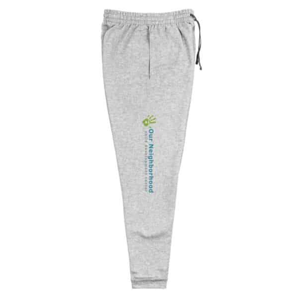 "unisex, off white joggers, text reads ""our neighborhood"" down the side of the leg"