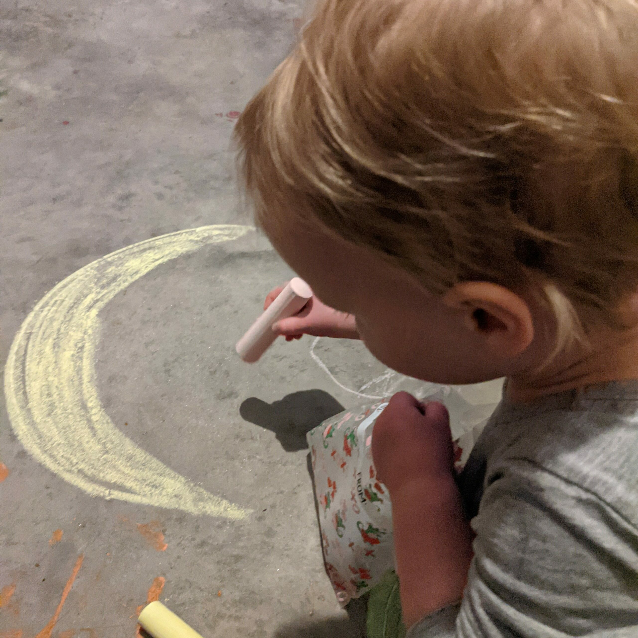 A child draws with chalk, moon, focus, drawing, art, expression