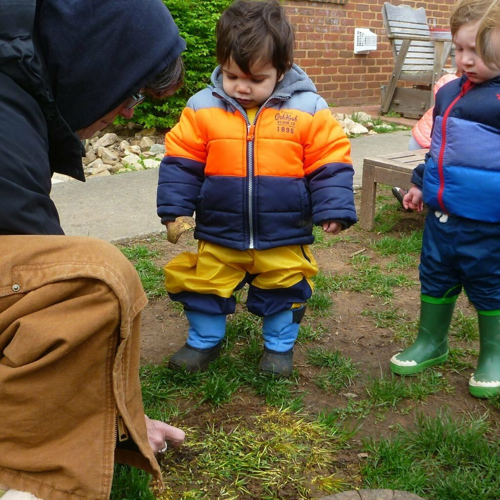 community resources square - teachers engage in outdoor play with toddlers, providing sensory experiences