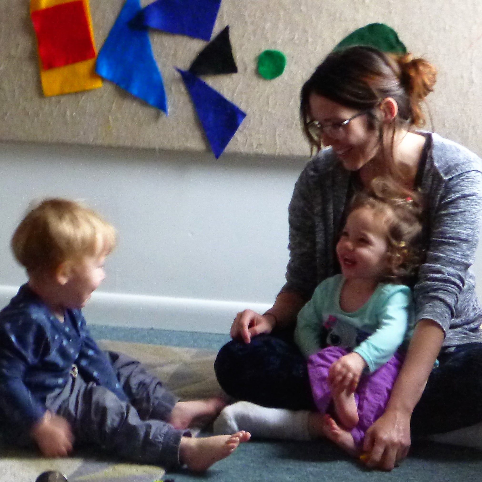 sq what is high quality early childhood - primary caregiver builds relationships with tots through joyful moments